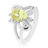 Csillogó gyűrű szétválasztott szárakkal, sárgás zöld és átlátszó cirkóniák, fényes ívek