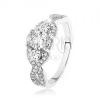 Csillogó 925 ezüst gyűrű, keresztezett hullámos szárak, ovális cirkónia