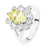 Csillogó gyűrű ezüst árnyalatban, sárga ovális, átlátszó cirkóniás szegély