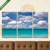 Képáruház.hu Napsütötte tengerpart felhőkkel(125x70 cm, L01 Többrészes Vászonkép)